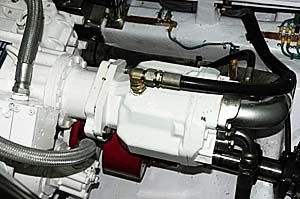 A large hydraulic pump bolted directly to a transmission PTO