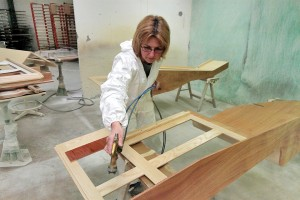 Polyurethane- and polyester-based finishes are applied in five booths